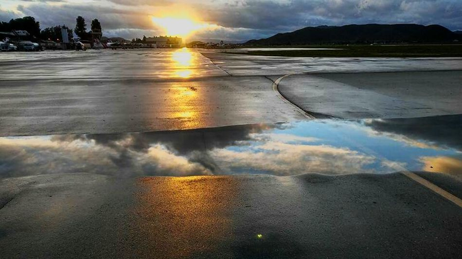 Water Reflection Sunset Outdoors Landscape Cloud - Sky Sunlight No People Lake Mountain Scenics Nature Day Beauty In Nature Sky Flood Hot Spring Reflections Airport Runway Aircraft After The Storm Infinity Unique Perspective Perspective Changes Everything Universe