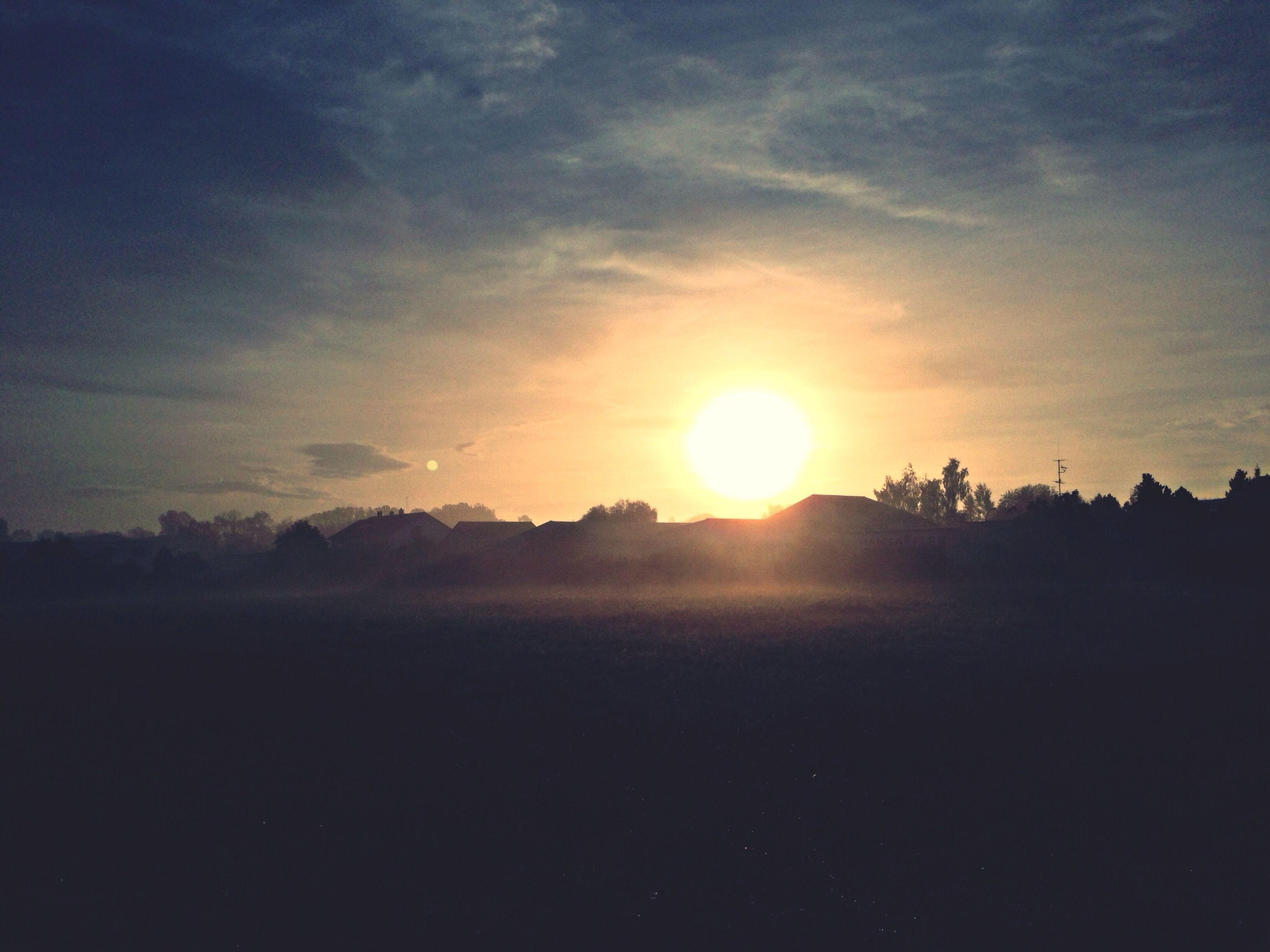 sun, sunset, tranquil scene, tranquility, scenics, beauty in nature, sky, silhouette, sunlight, sunbeam, nature, landscape, idyllic, lens flare, tree, cloud - sky, orange color, non-urban scene, outdoors, no people