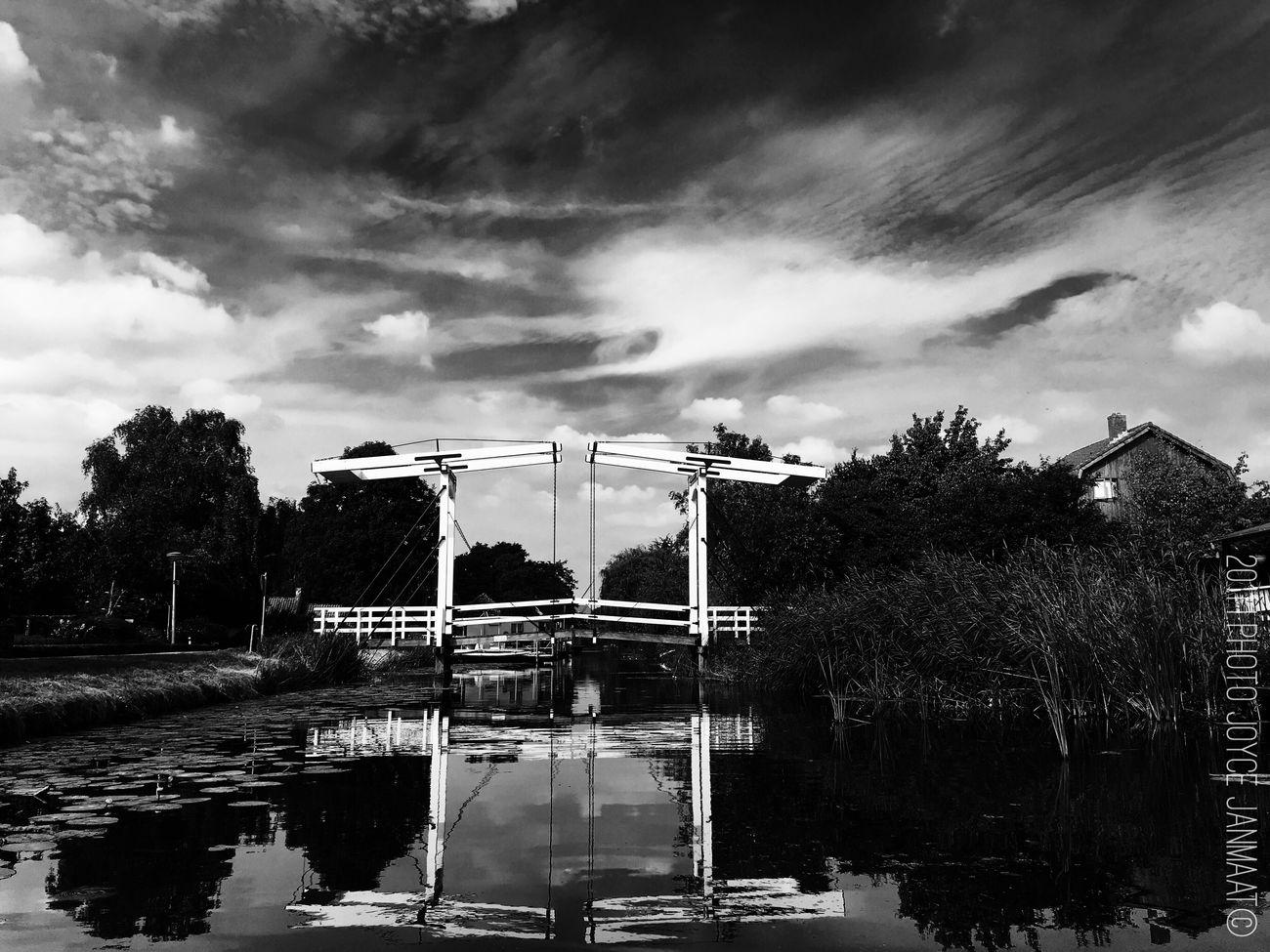 Showcase July Dutch Bridge Bridges Bridgesaroundtheworld Bridgeporn Bridge Over Water Dutch Canals Dutchstyle Netherlands Thenetherlands Nederland Puttershoek Black&white Iphone6splus Hidden Gems  Holland Monochrome Photography Light And Reflection