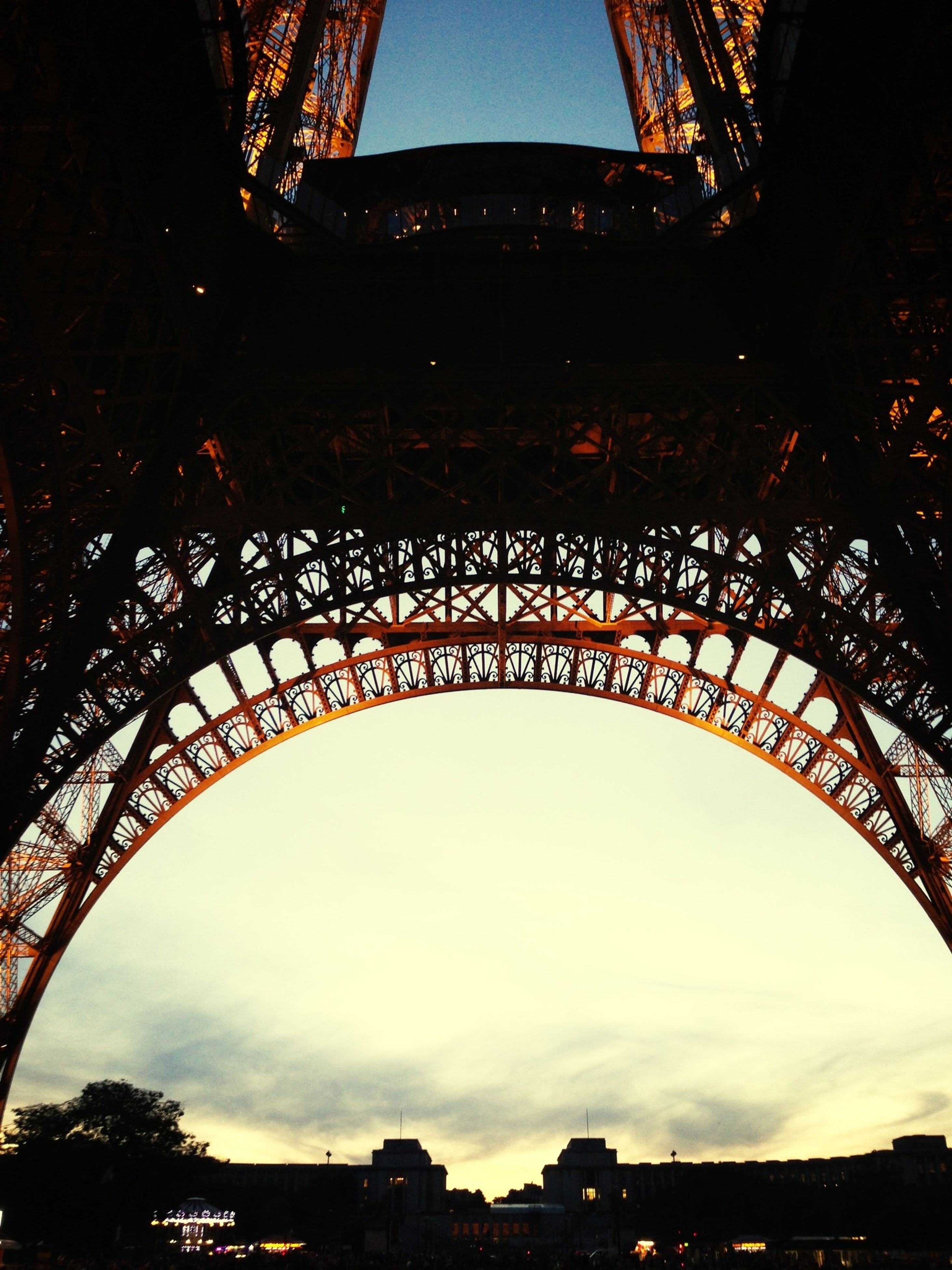 architecture, built structure, low angle view, famous place, bridge - man made structure, international landmark, travel destinations, history, sky, connection, engineering, arch, tourism, travel, building exterior, capital cities, culture, eiffel tower, city, metal