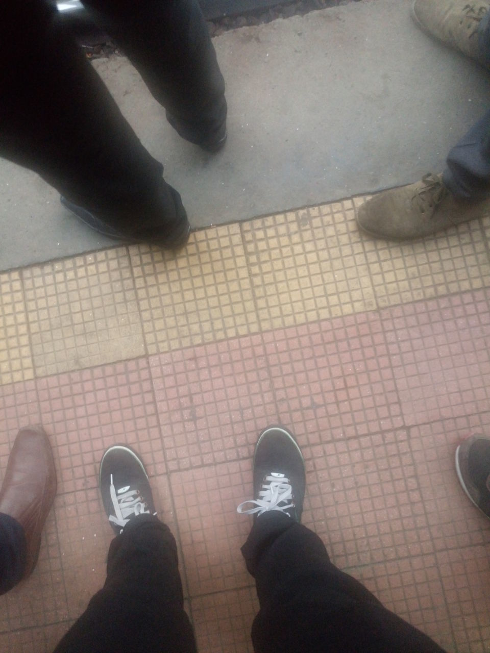 low section, shoe, human leg, standing, real people, high angle view, human body part, men, personal perspective, indoors, lifestyles, day, friendship, close-up, people, adult