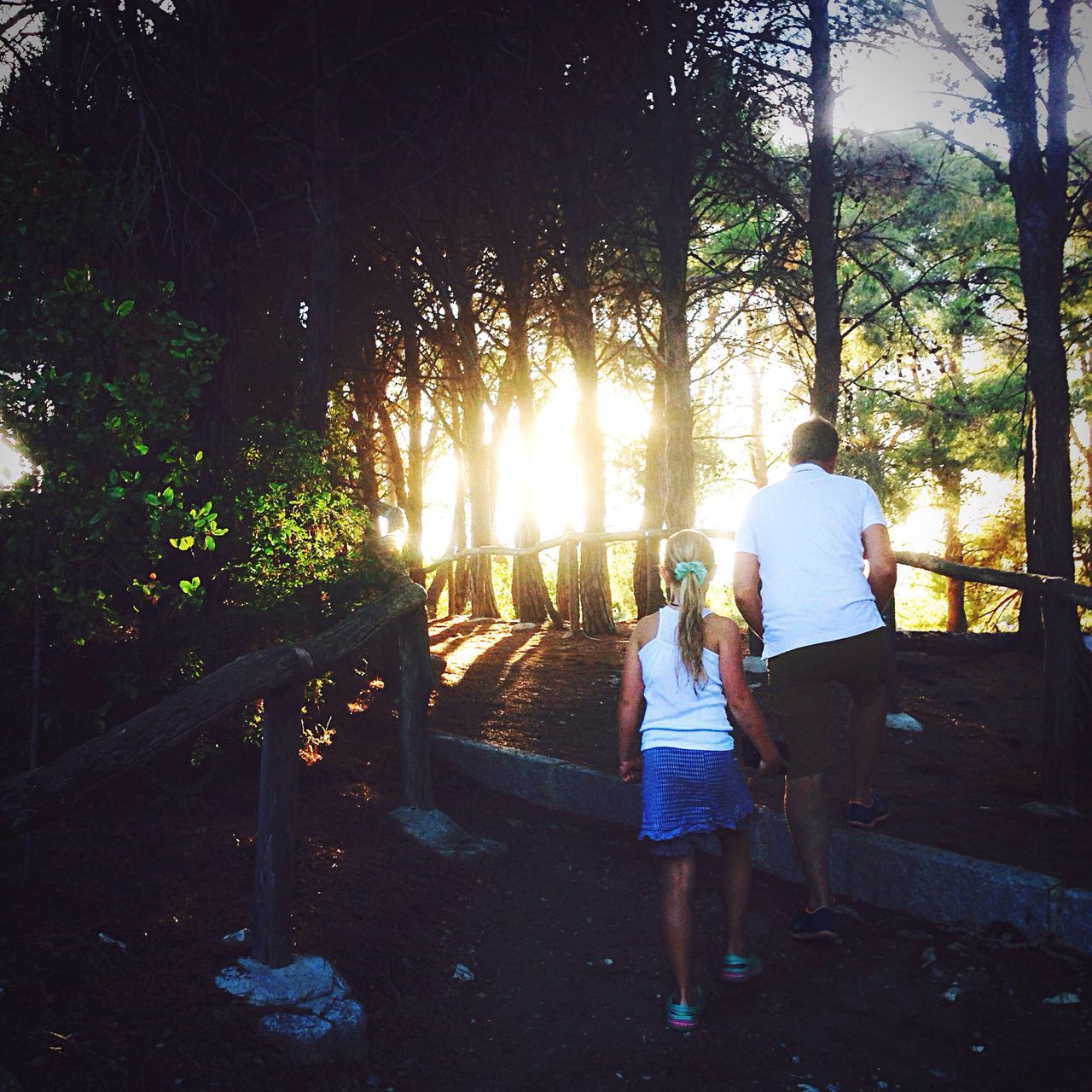 Father And Daughter Togetherness Relaxation In Front Of Sundown Footpath Fatherhood Moments