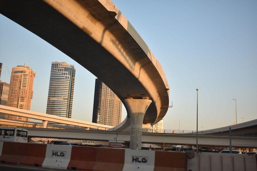 Architecture Bridge - Man Made Structure City Cityscape Clear Sky Cultures Day Development Downtown District Futuristic Highway Modern No People Outdoors Sky Skyscraper Sunlight Travel Travel Destinations Urban Skyline
