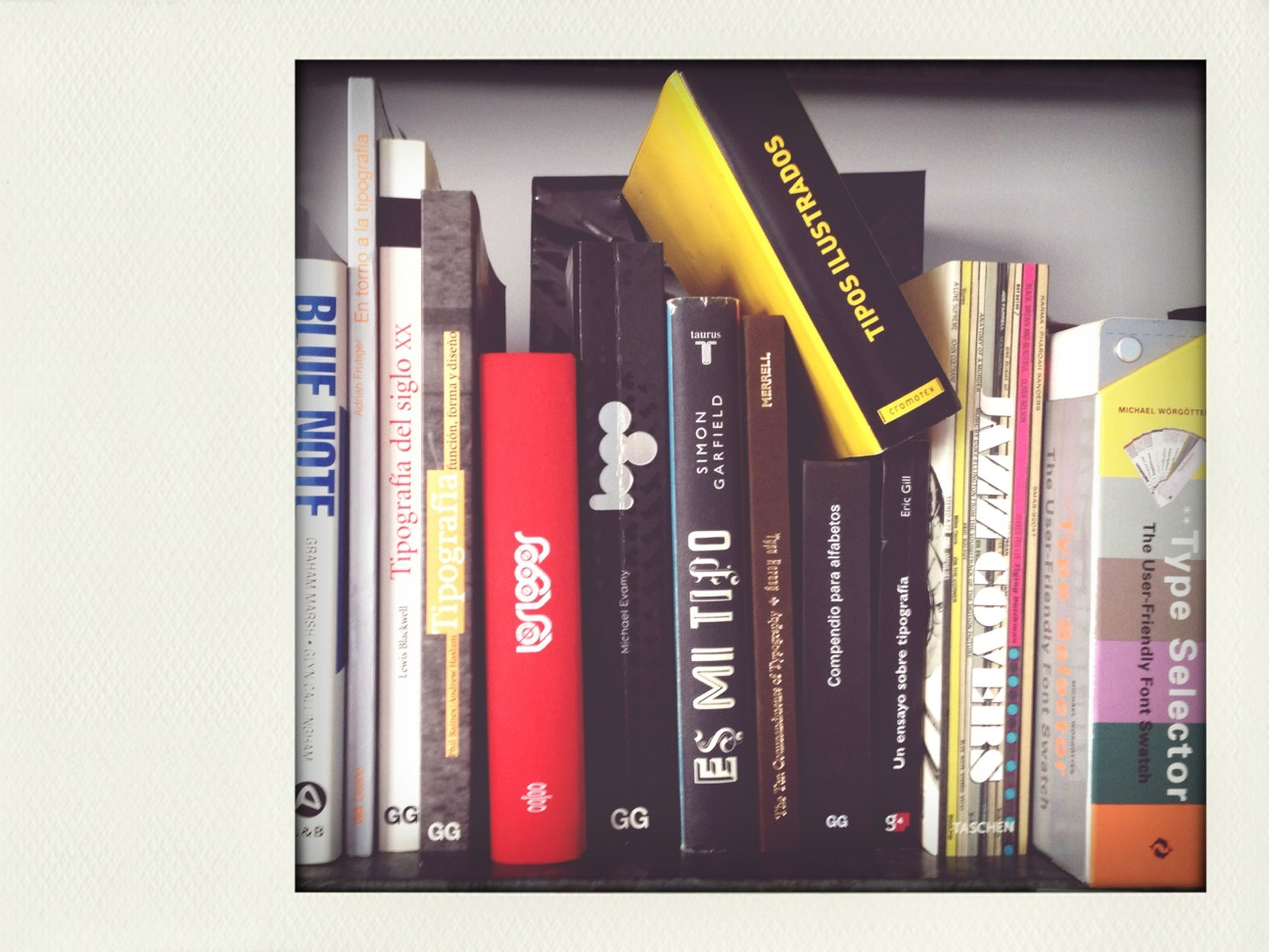 text, western script, multi colored, variation, communication, indoors, in a row, education, large group of objects, no people, order, choice, book, arrangement, side by side, auto post production filter, shelf, architecture, non-western script, abundance