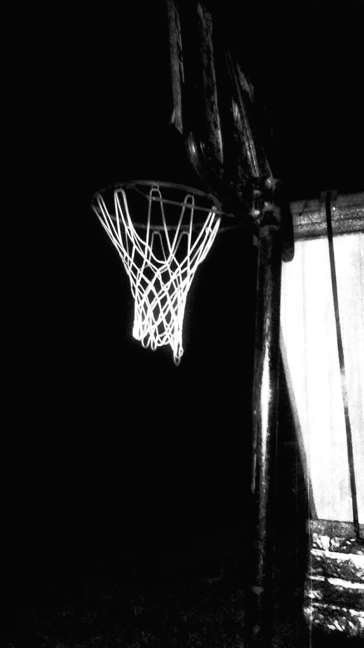 Basketball Hoop On Court At Night