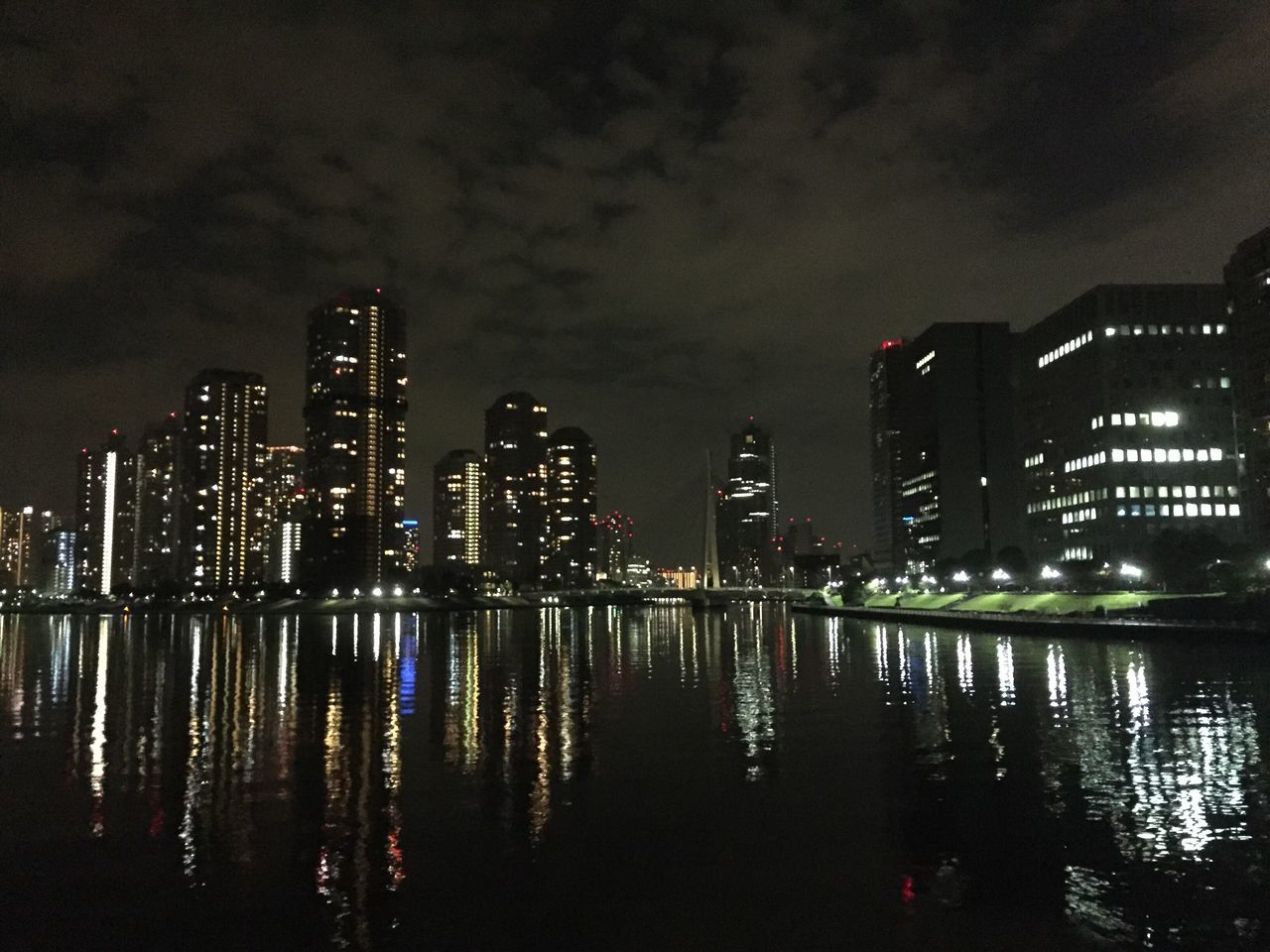 City Reflection Architecture Skyscraper Illuminated Building Exterior Modern Night Built Structure Water Waterfront Sky Travel Destinations Outdoors River Cityscape No People Urban Skyline Futuristic