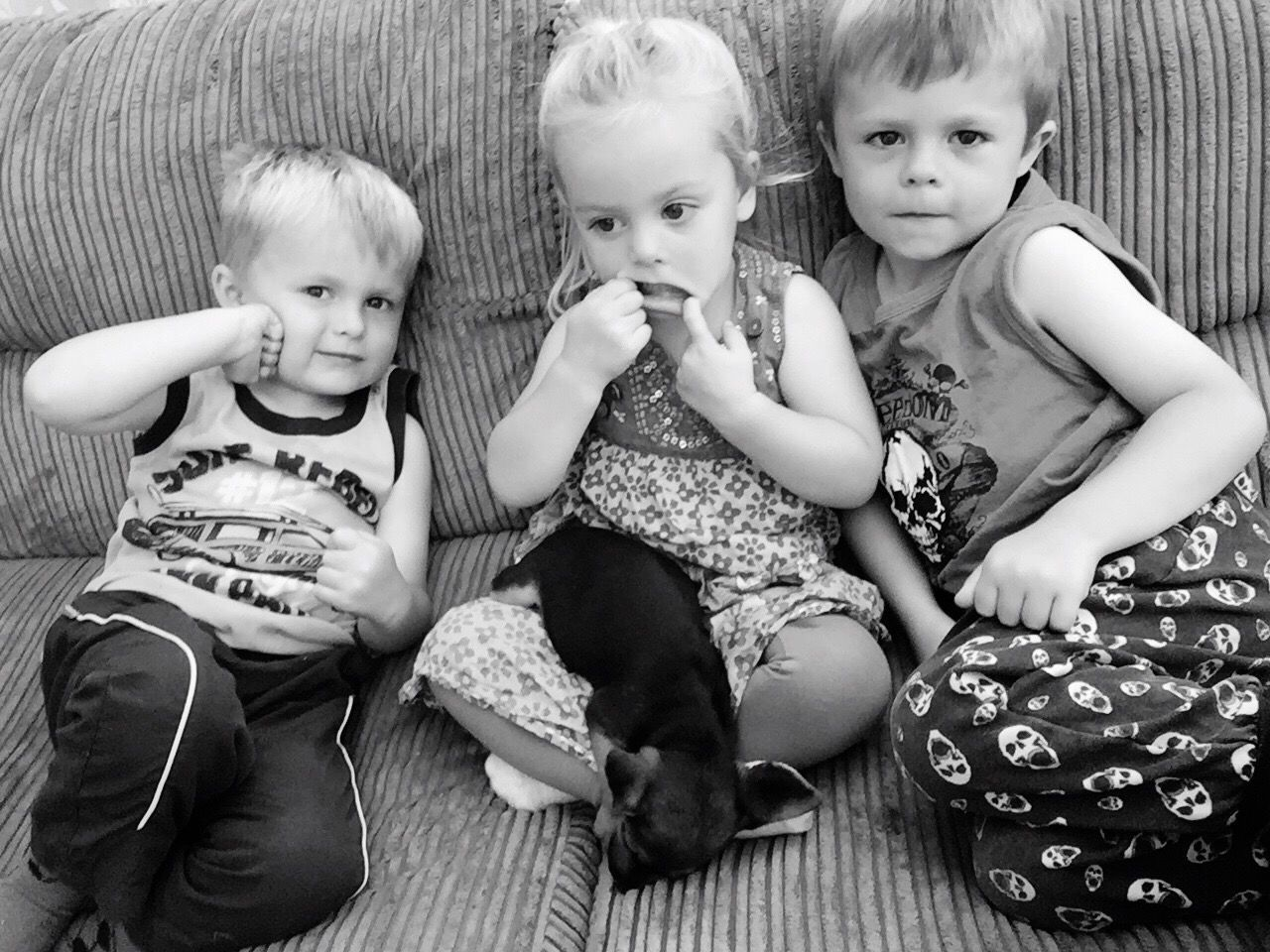 innocence, childhood, baby, real people, cute, sitting, babyhood, looking at camera, togetherness, casual clothing, love, indoors, bonding, full length, girls, portrait, happiness, lifestyles, boys, day, animal themes, pets, mammal, people