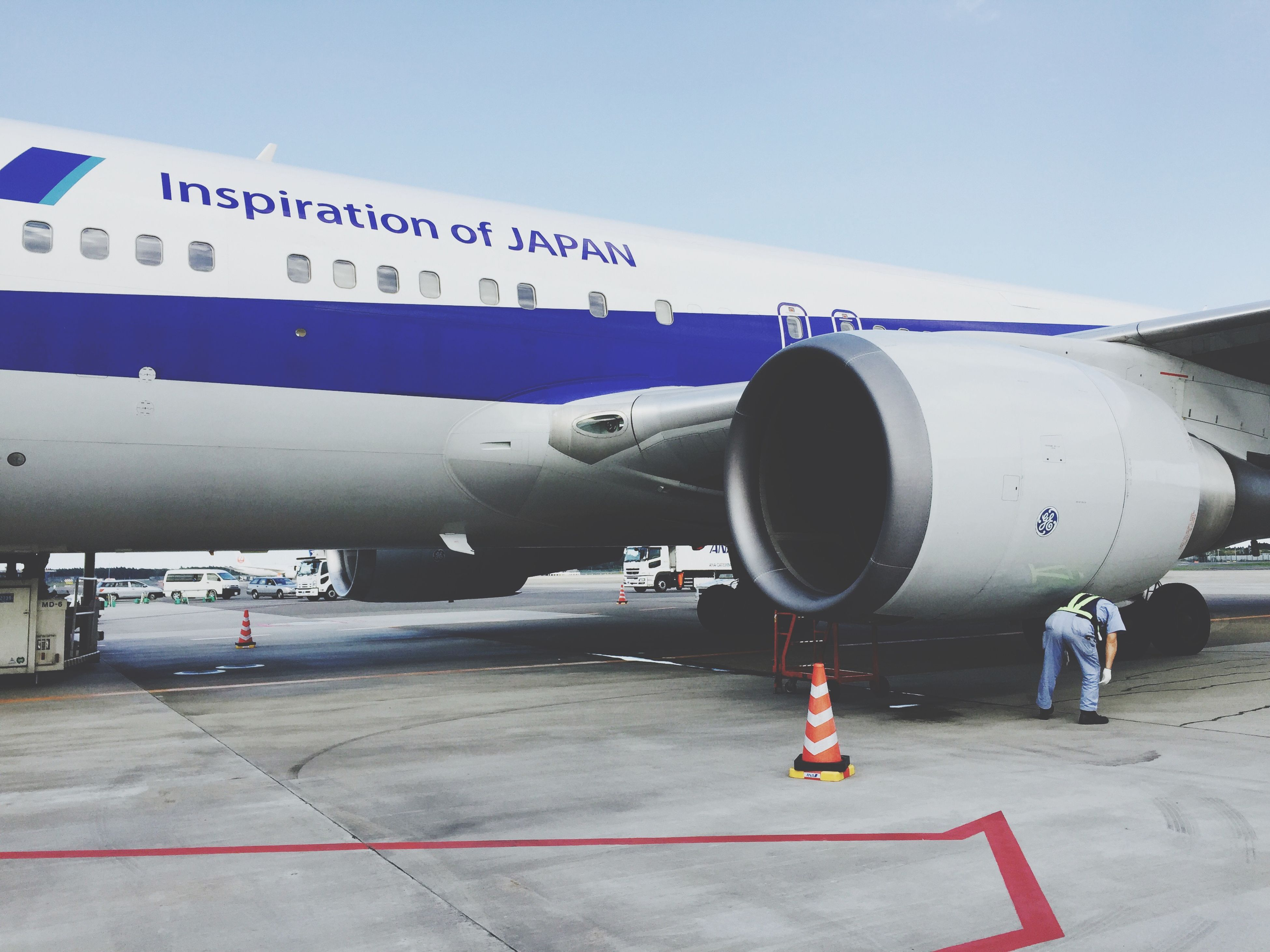 transportation, airplane, mode of transport, air vehicle, travel, sky, built structure, day, part of, blue, aircraft wing, outdoors, clear sky, cropped, airport runway, journey, architecture, no people, metal, land vehicle