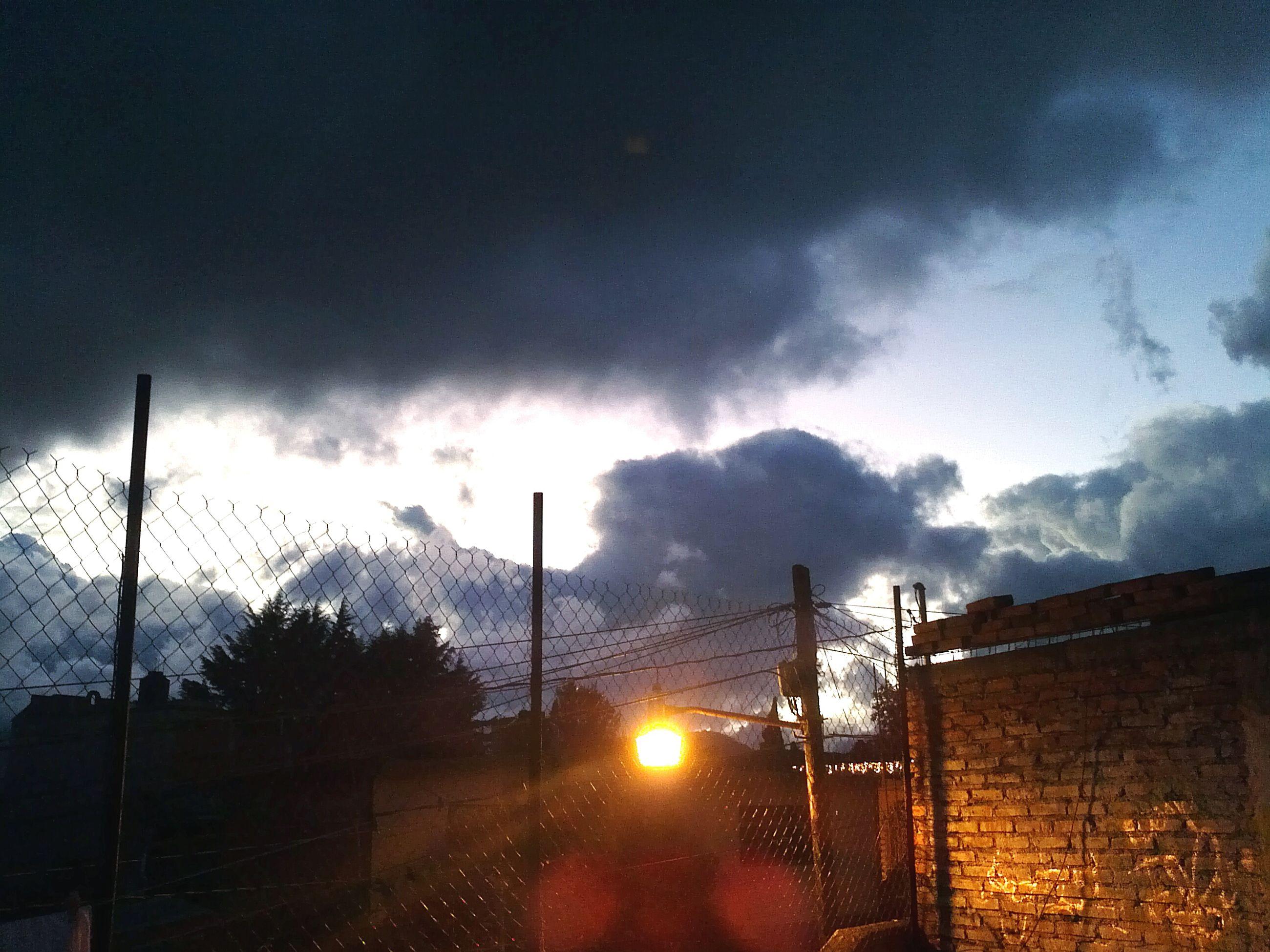 sky, cloud - sky, cloudy, weather, built structure, building exterior, architecture, street light, fence, cloud, dusk, overcast, storm cloud, nature, no people, factory, outdoors, house, transportation, road