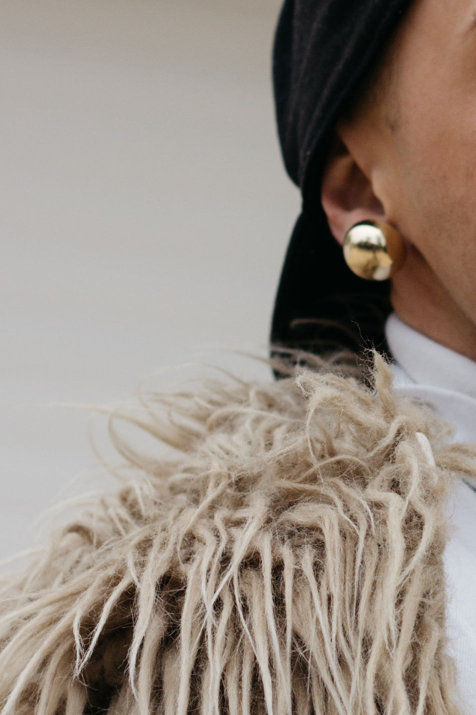 Fashion details close up - drag queen earings, cap, fake fur coat Accesories Accessories Alternative Cap Close-up Day Detail Dragqueen  Enjoying Life Headshot Indoors  Lifestyles Mammal One Person People Real People White Background Young Adult