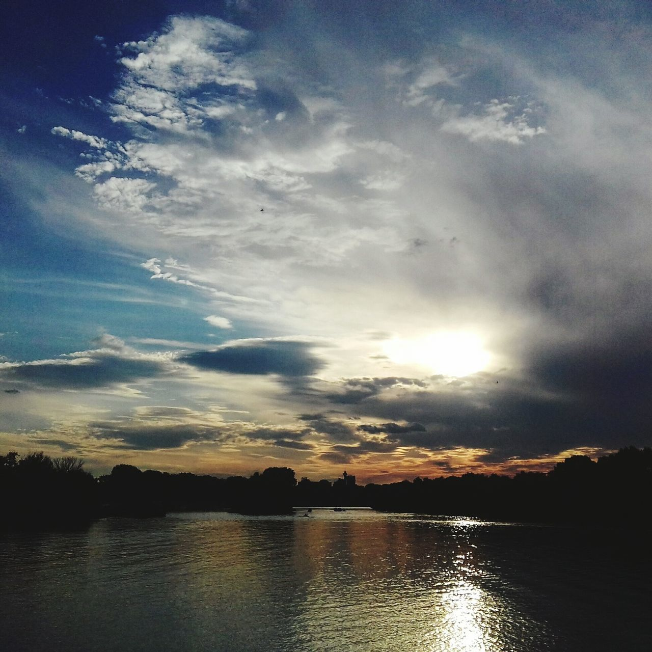 sunset, water, reflection, sky, scenics, nature, tranquility, beauty in nature, no people, tranquil scene, lake, sun, cloud - sky, silhouette, outdoors, day