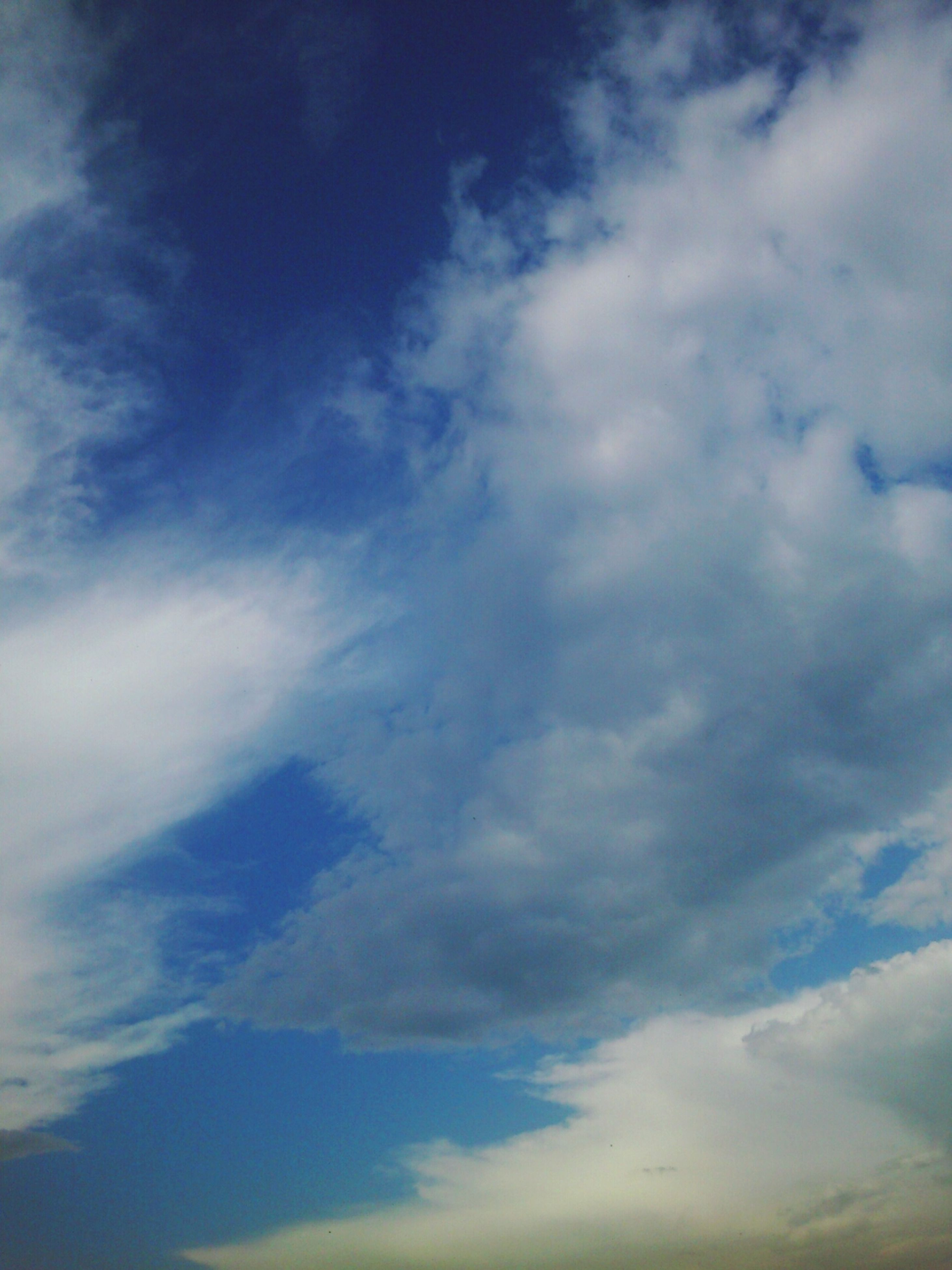 sky, cloud - sky, low angle view, beauty in nature, tranquility, cloudy, scenics, tranquil scene, nature, cloud, sky only, blue, backgrounds, cloudscape, full frame, idyllic, outdoors, no people, day, white color