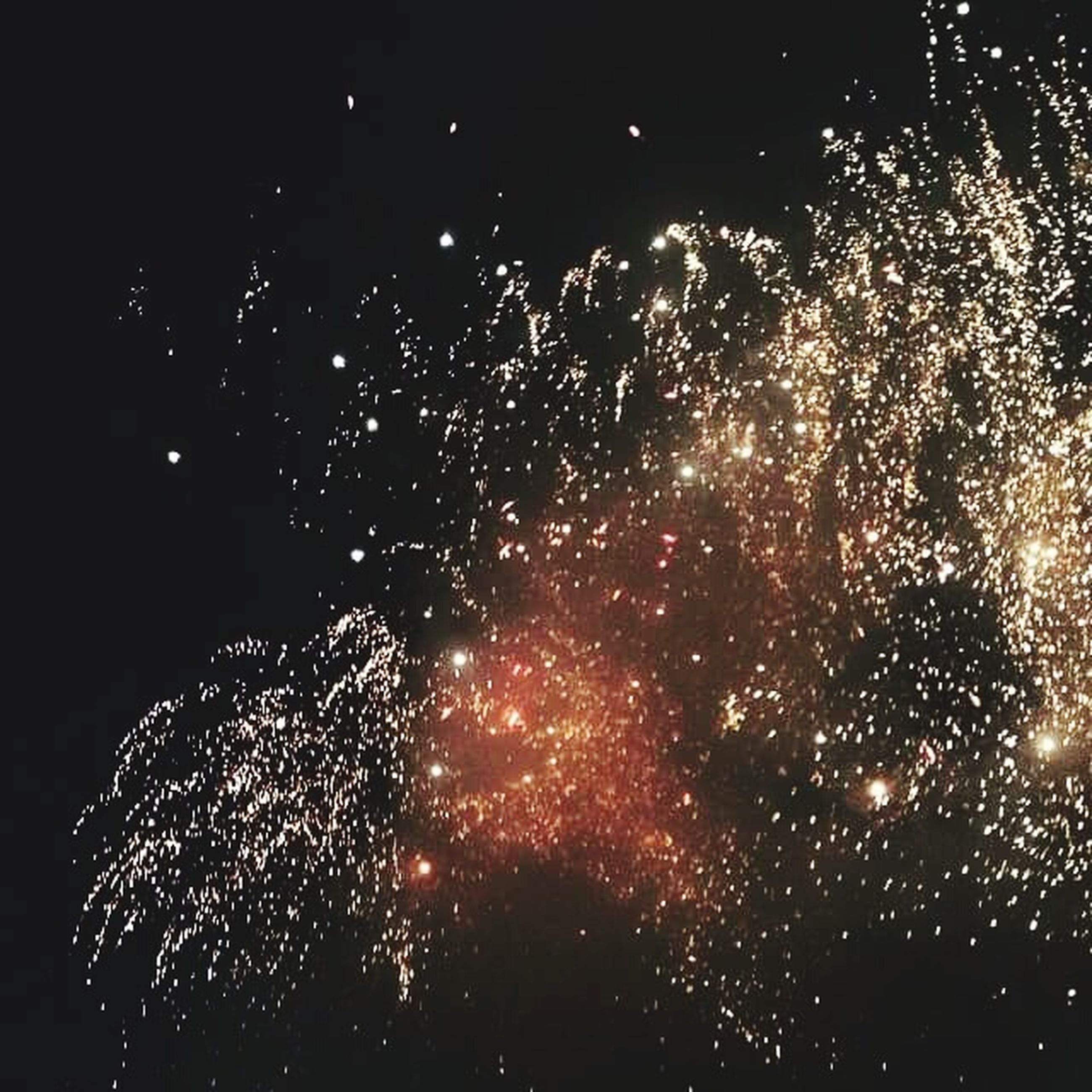 night, illuminated, celebration, firework display, glowing, low angle view, long exposure, motion, exploding, firework - man made object, sparks, firework, arts culture and entertainment, dark, light, lighting equipment, event, no people, sky, light - natural phenomenon