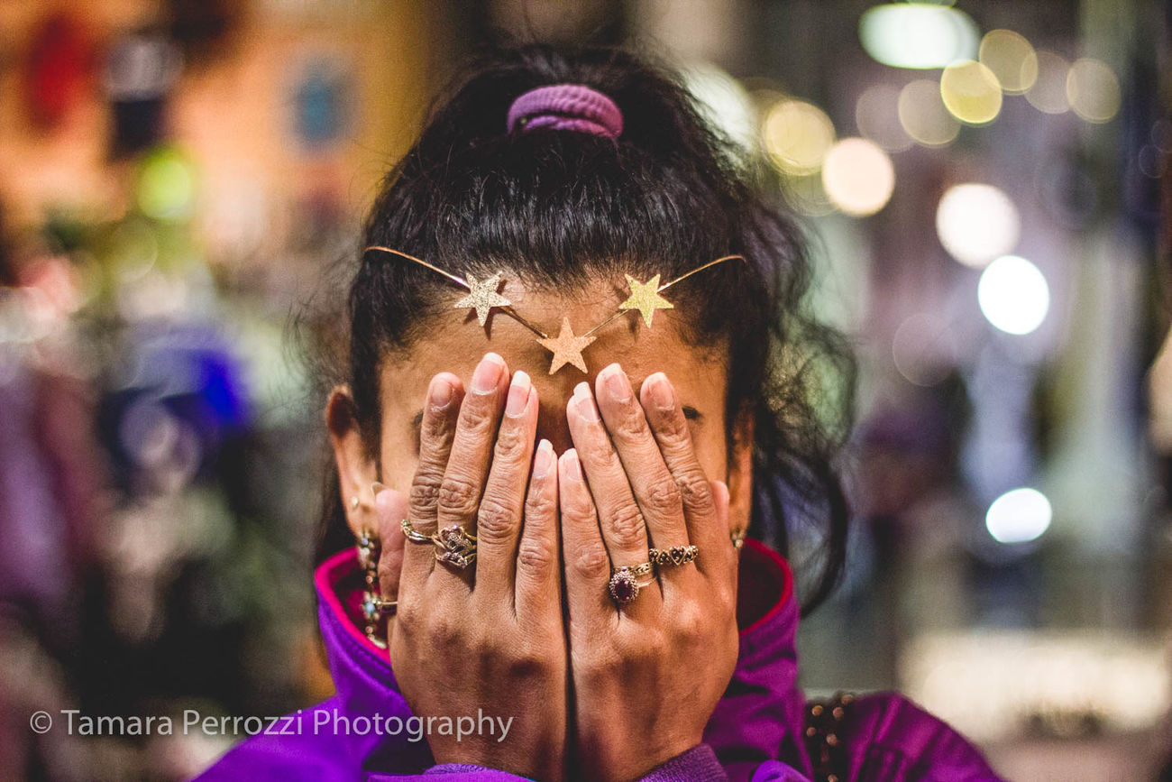 Hide away and let your imagination run wild Adult Close-up Communication Eyeglasses  Focus On Foreground Front View Headshot Human Hand Leisure Activity Lifestyles Light, Yellow, Red, Bokeh, Night, Background Night One Person Outdoors People Real People Women