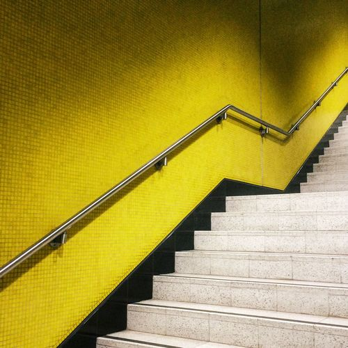 Paint The Town Yellow Staircase Steps And Staircases Steps Railing Stairs Architecture Yellow Spiral Built Structure Hand Rail No People Indoors  Low Angle View Spiral Staircase Zigzag Day Close-up Hongkong Shot On IPhone.