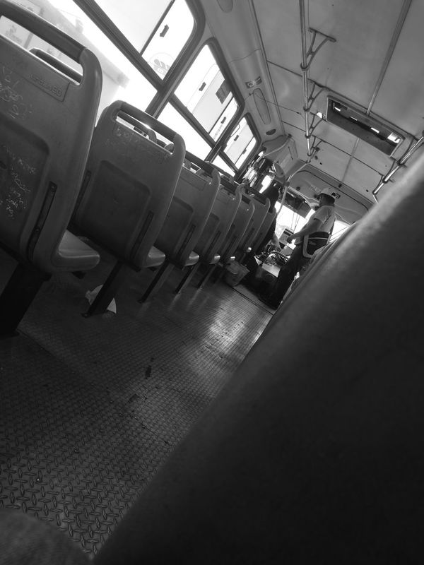 Indoors  Low Angle View Bus Traveling Commute Empty Chairs