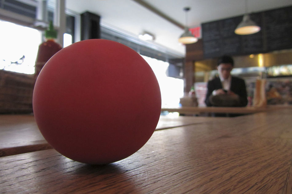 A bouncing ball Ball Bouncing Ball Close-up Focus On Foreground Pink Selective Focus Sphere Still Life Toy Wood - Material