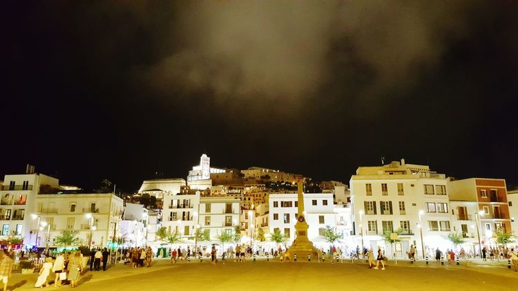Architecture Building Exterior Built Structure Night Illuminated Large Group Of People In Front Of Outdoors Sky Façade City Life Crowd Vacations Ibiza Town Clouds And Sky Cloud Light Clouds Night Photography Nightphotography Town At Night