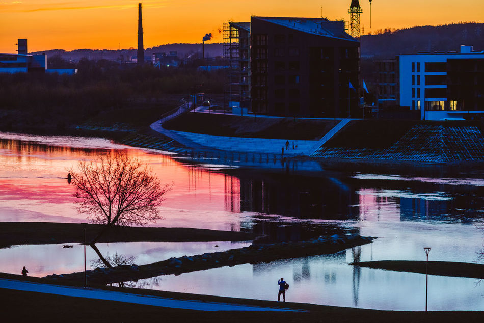 Evening Slihouettes Architecture Bare Tree Beauty In Nature Building Exterior Built Structure City Life Cold Temperature Kaunas Lithuania Nature Outdoors People Real People Reflection River Silhouette Silhouette Sky Spring Sunset Tree Water