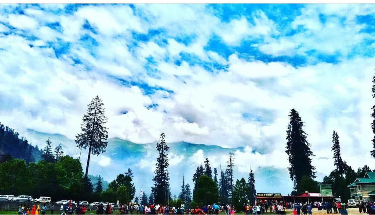 large group of people, sky, tree, cloud - sky, day, crowd, outdoors, men, nature, real people, women, blue, beauty in nature, travel destinations, built structure, architecture, panoramic, people