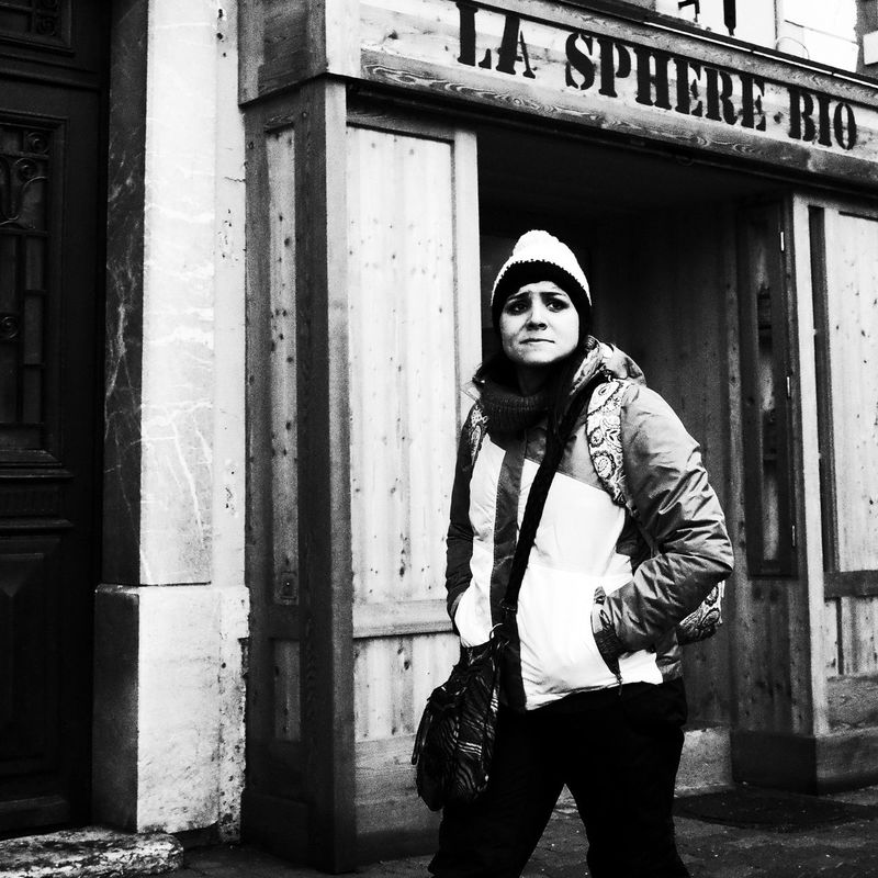 Noir Et Blanc Blackandwhite Building Exterior Day Front View Lifestyles Looking At Camera One Person Outdoors Real People Standing Street Photography Streetphotography Three Quarter Length Warm Clothing Women