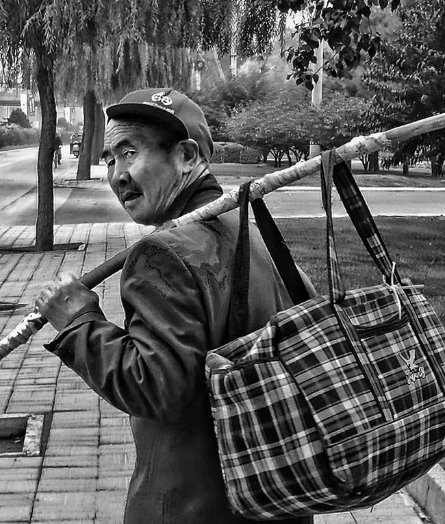 Monochrome Photography migrant walking alone close to Chaoyang park Beijing, China BEIJING北京CHINA中国BEAUTY China In My Eyes Street Photos😄📷🏫⛪🚒🚐🚲⚠ Eye4photography  China Photos Street Photography My Beijing 2016 Chaoyang Park EyeEm Gallery This Is Beijing Looking At Camera Portrait HUMANITY At The Corner Of The Street People And Places. Person Street Solitude Eye4photography  Streetphotography_bw Streetphoto_bw Streetphotography One Person