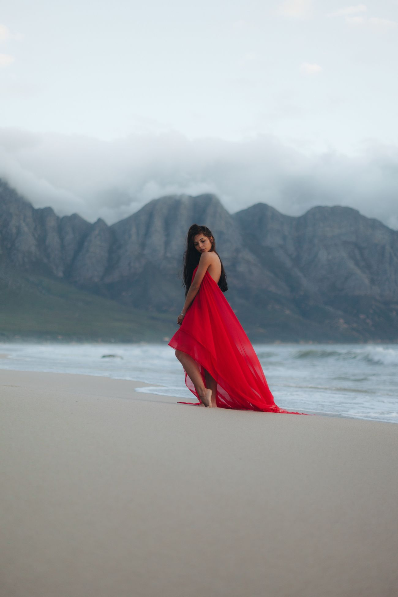 Beach South Africa Cape Town One Young Woman Only Beauty In Nature Portrait Mountain Landscape Women Standing Outdoors One Person Red Full Length Young Adult Standing Mountain Range Sky Nature Tranquility Scenics Day Beauty In Nature Women Around The World