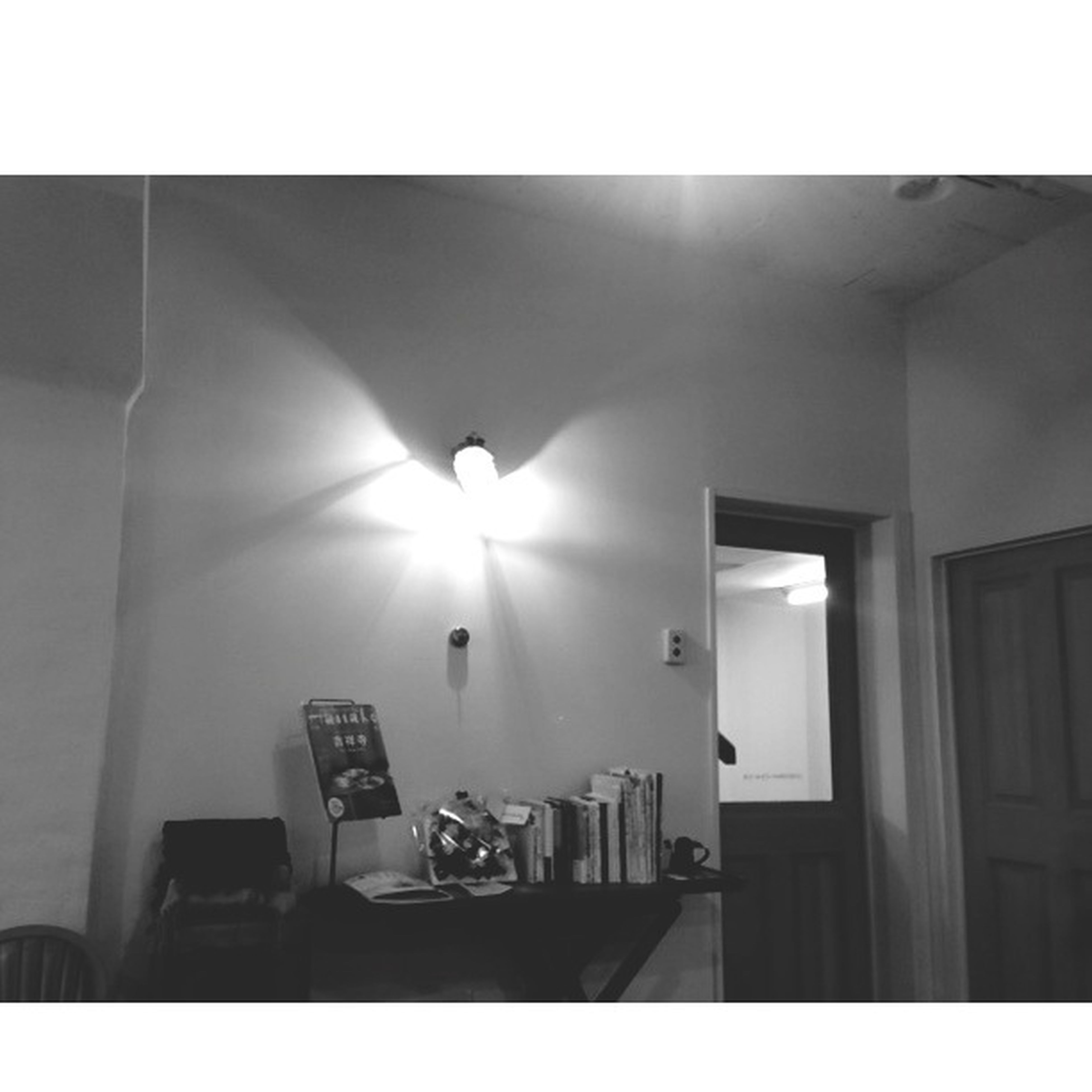 indoors, transfer print, illuminated, auto post production filter, lighting equipment, built structure, architecture, ceiling, window, home interior, light - natural phenomenon, house, sunlight, no people, electric lamp, wall - building feature, low angle view, wall, glowing, domestic room
