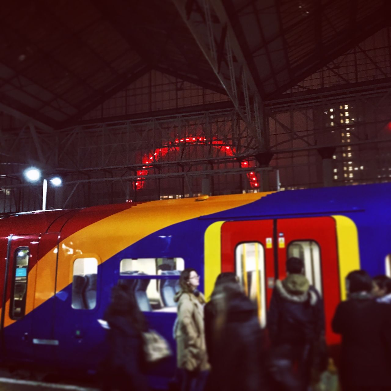 public transportation, train - vehicle, illuminated, transportation, red, real people, rail transportation, built structure, night, men, women, architecture, sky, outdoors, people