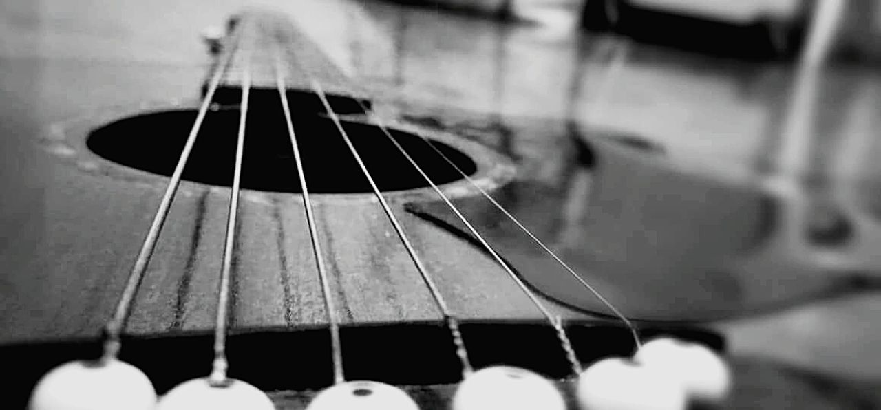 music, musical instrument, musical instrument string, guitar, arts culture and entertainment, musical equipment, fretboard, acoustic guitar, woodwind instrument, string instrument, close-up, indoors, no people, classical music, day