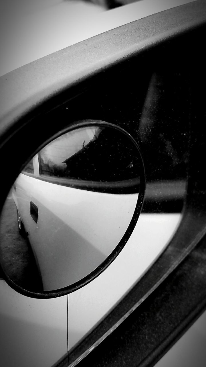 side-view mirror, transportation, mode of transport, reflection, no people, close-up, day, vehicle mirror, outdoors, sky