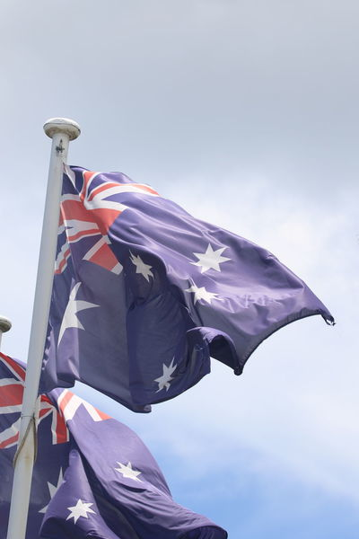 Australian Flag Day Flag Flag Pole Fluttering Low Angle View National Icon No People Outdoors Patriotism Pride Sky Waving Wind