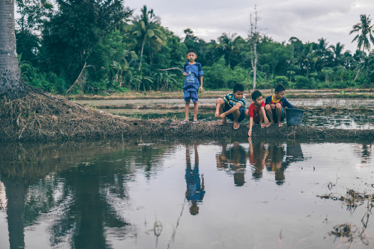 Fishing Time Boys Child Childhood Day Fishing Friendship Full Length Kid Leisure Activity Lifestyles Nature Outdoors People Real People Rural Scene Togetherness Tree Unity Vacations Water
