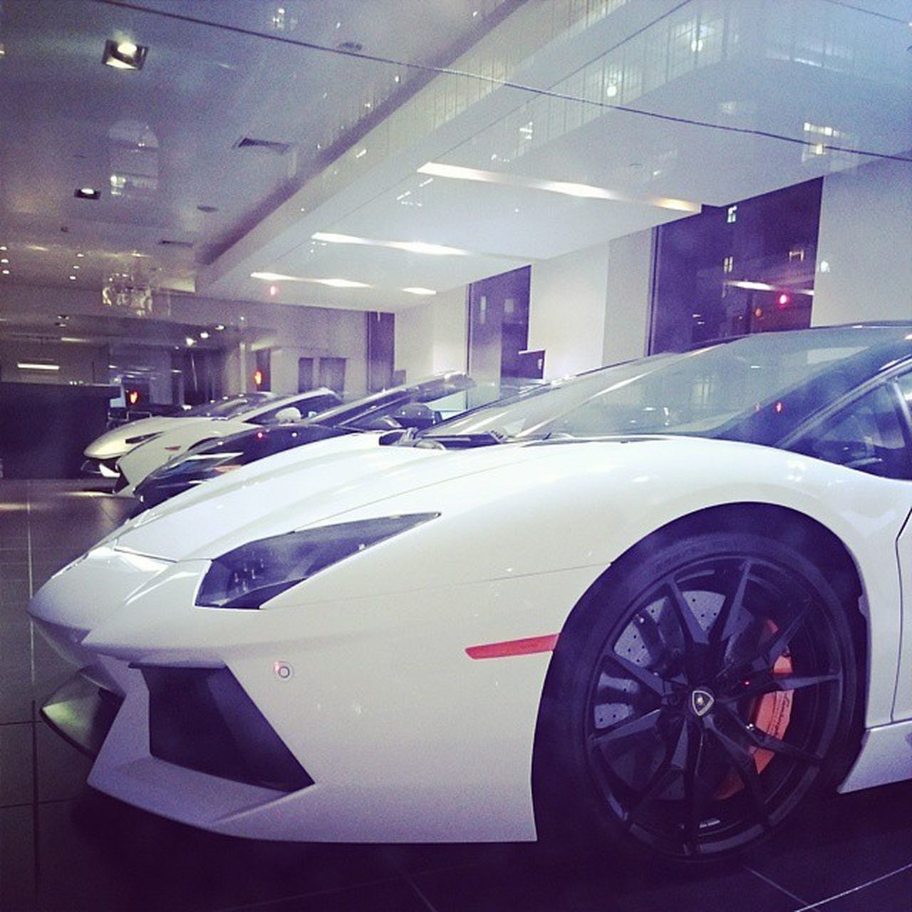 car, transportation, mode of transport, land vehicle, luxury, illuminated, stationary, indoors, no people, modern, technology, day