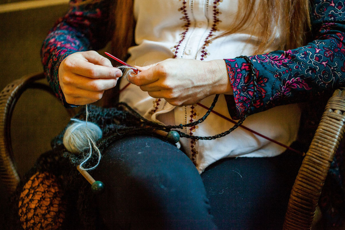 Art And Craft Close-up Creativity Day Expertise Fashion Holding Human Body Part Human Hand Indoors  Knitting Knitting Needle Making Midsection One Person Preparation  Real People Sewing Sitting Skill  Textile Women Wool Working Workshop