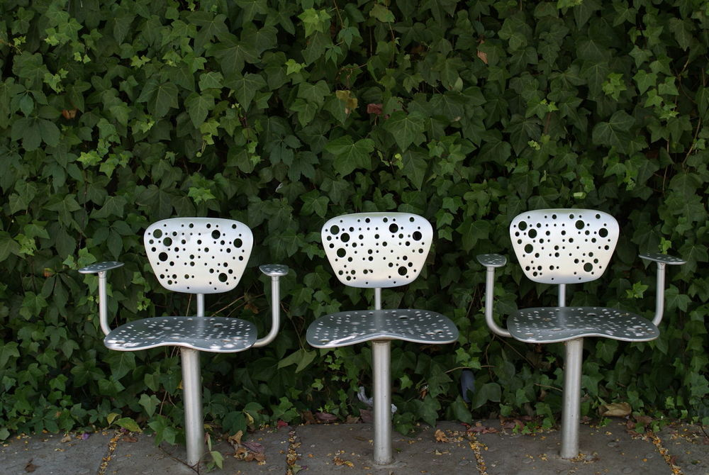 Three Seats Day Foliage Green Leaf Leaves Man Made Metal Seat Metal Seats No People Number 3 Number Three Outdoors Public Public Places Seat Seats,play Area. Three