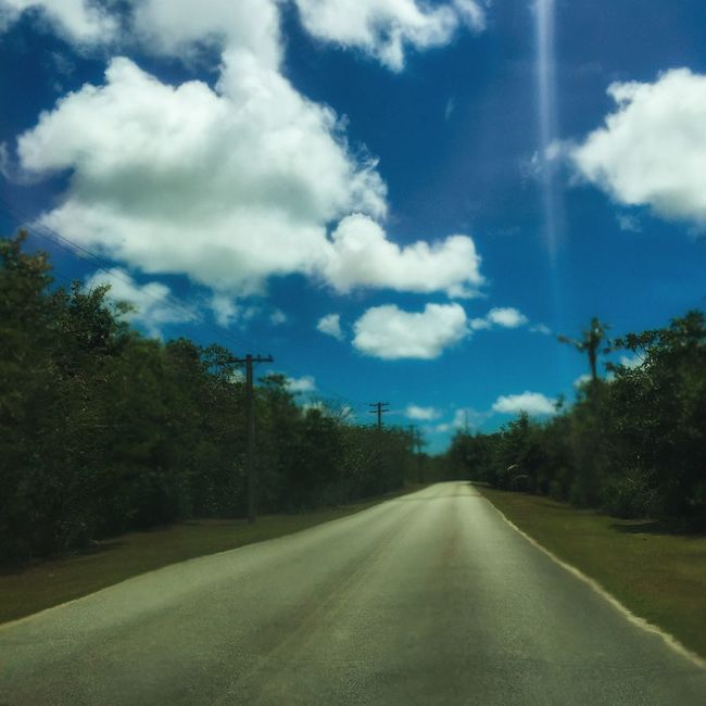 Roadtrip Road Hot Day Trees And Sky Photography In Motion IPhoneography Check This Out Hanging Out Hello World Taking Photos Showcase : March Sunset #sun #clouds #skylovers #sky #nature #beautifulinnature #naturalbeauty #photography #landscape Sunshine Lonely Guam Guamlife GUAM..a Place I Call Home Landscapes With WhiteWall Landscape Getty X EyeEm Blue Wave