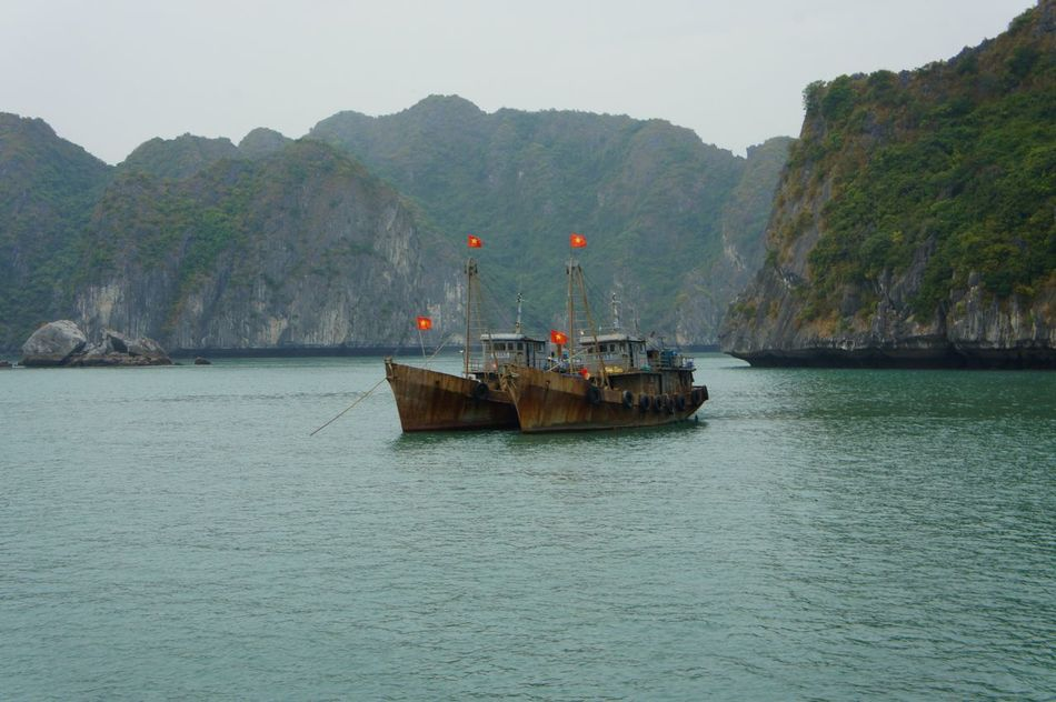 Astrology Sign Ferry Flag Ha Long Bay Halong Halong Bay Vietnam Halongbay HalongbayCruise Mountain Nature Nautical Vessel No People Outdoors Passenger Craft Sea Water