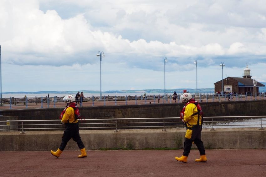 RNLI rescue call out RNLI Day Lifeboat RNLI Men Real People Rescue Sky Teamwork Yellow