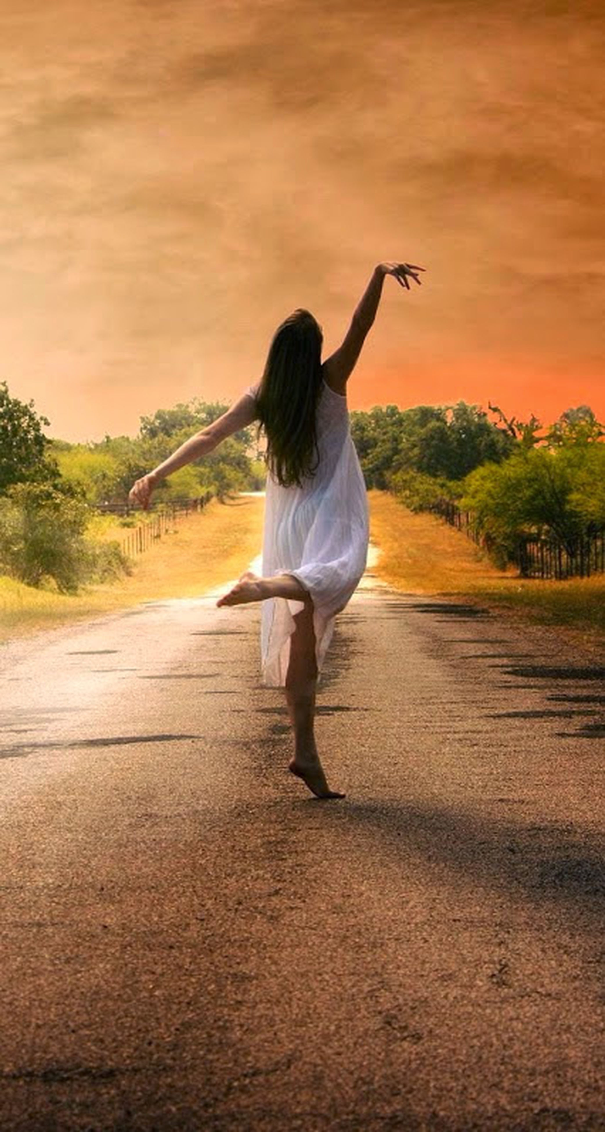 full length, lifestyles, leisure activity, rear view, casual clothing, sky, standing, tree, sunset, walking, long hair, person, road, side view, young adult, motion, young women, the way forward