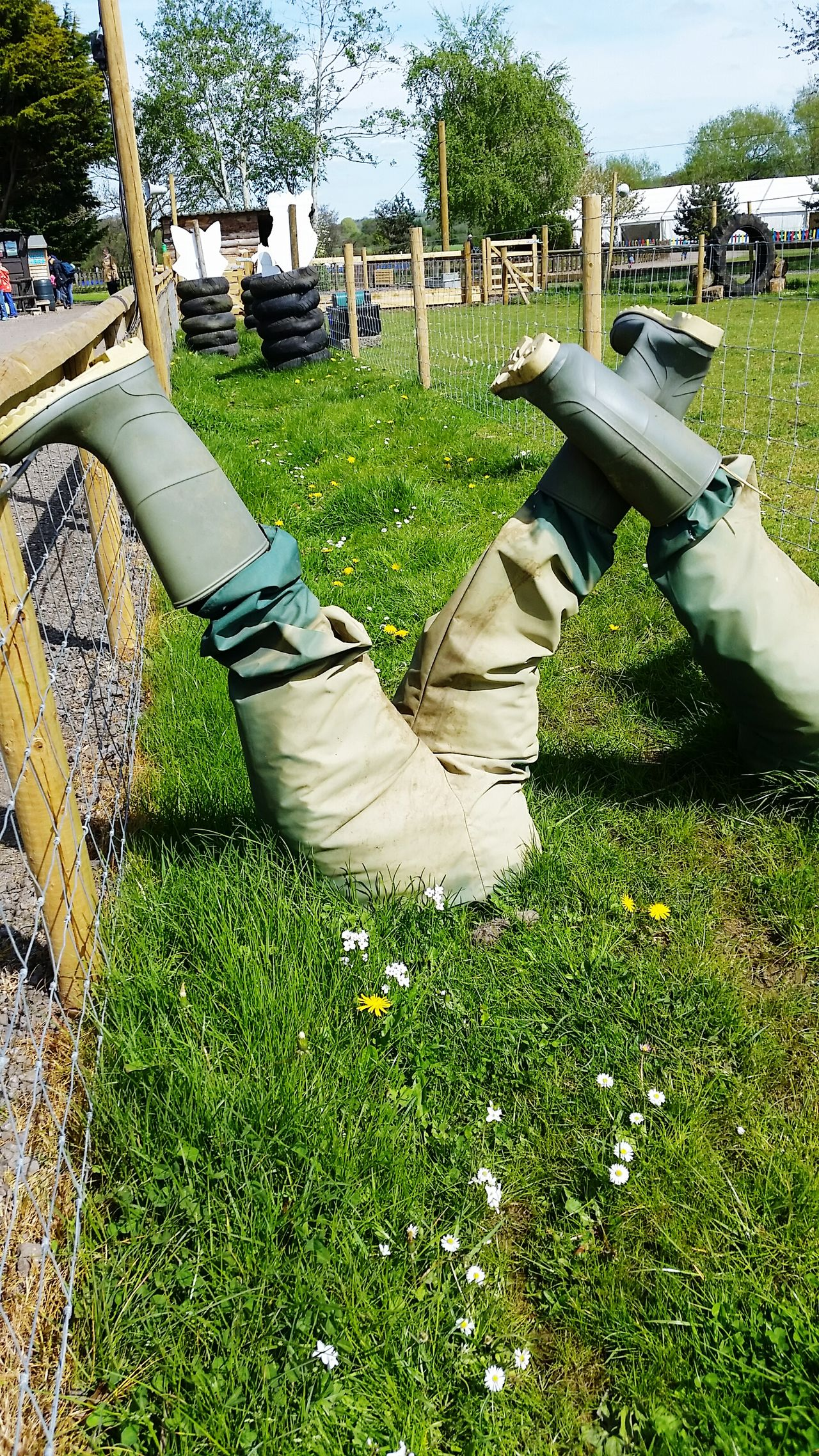 Front Or Back Yard Lawn Outdoors Day Park - Man Made Space No People Growth Nature Shadow Grass Tree Art Is Everywhere Happiness Human Body Part Adult People Legs Upside Down Upsidedown Wellington  Wellies  Wellington Boots Leisure Activity EyeEm Diversity Close-up