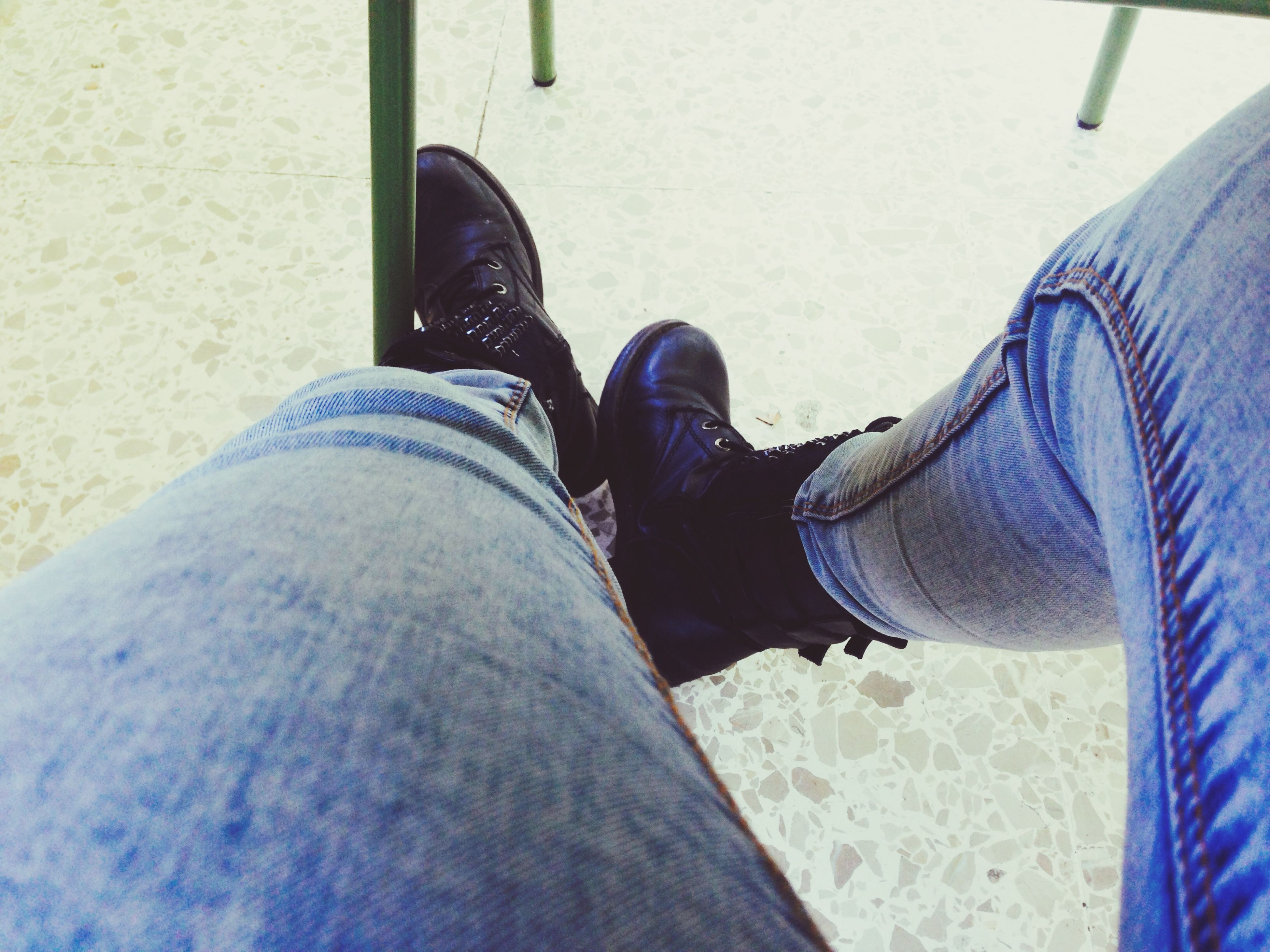 low section, person, shoe, personal perspective, jeans, footwear, lifestyles, human foot, relaxation, men, sitting, standing, part of, close-up, leisure activity, day, legs crossed at ankle