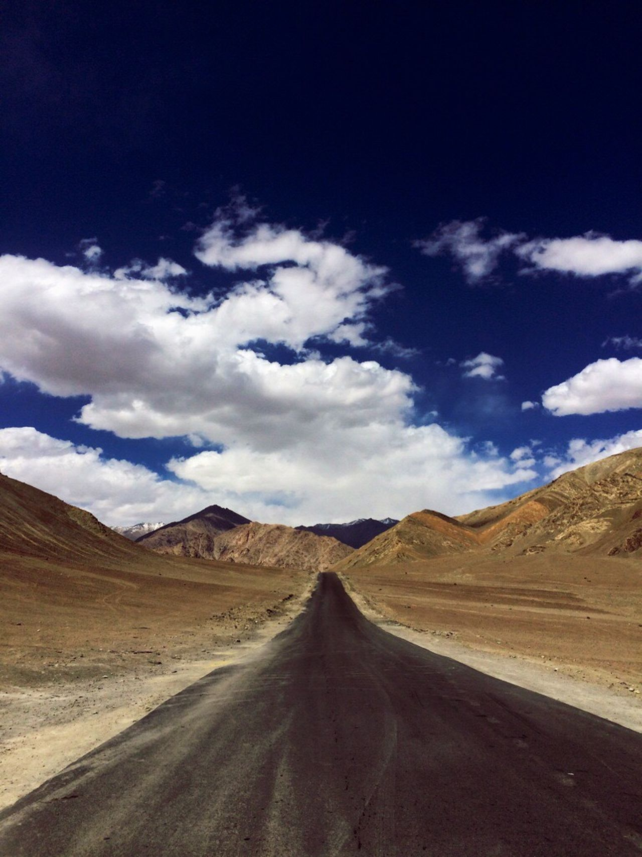 The Way Forward Diminishing Perspective Road Transportation Mountain Sky Vanishing Point Landscape Tranquil Scene Remote Tranquility Mountain Range Non-urban Scene Long Nature Country Road Cloud Cloud - Sky Blue Solitude India JammuandKashmir