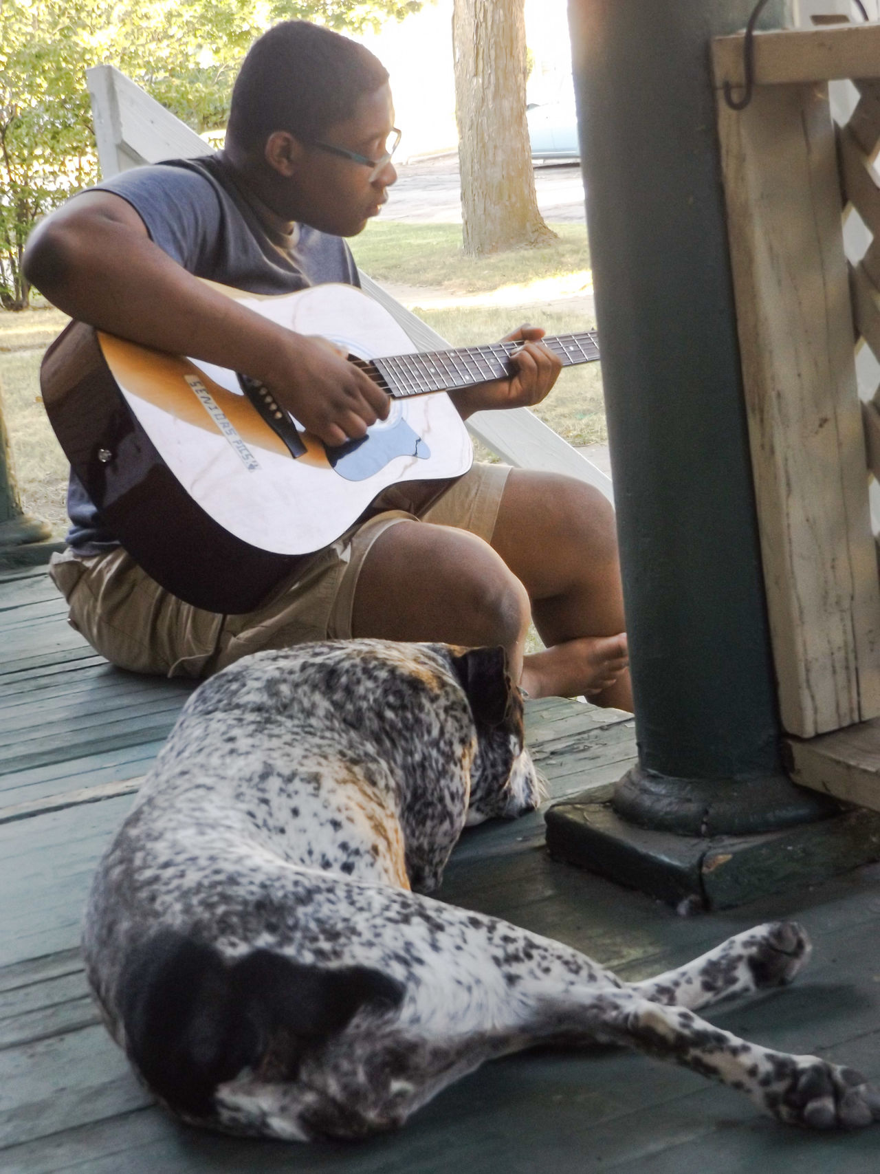 A Boy And His Dog Boy On Porch Dog On A Porch Boy And His Guitar Playing Music Outside Playing Music Jackson Michigan Porch Life Capture The Moment Two Is Better Than One