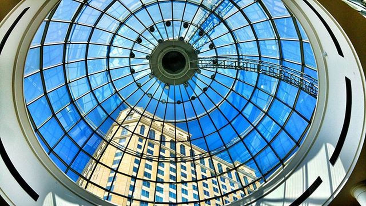 architecture, dome, built structure, low angle view, architectural feature, indoors, window, modern, ceiling, travel destinations, no people, day, cupola, concentric, sky, fish-eye lens, city