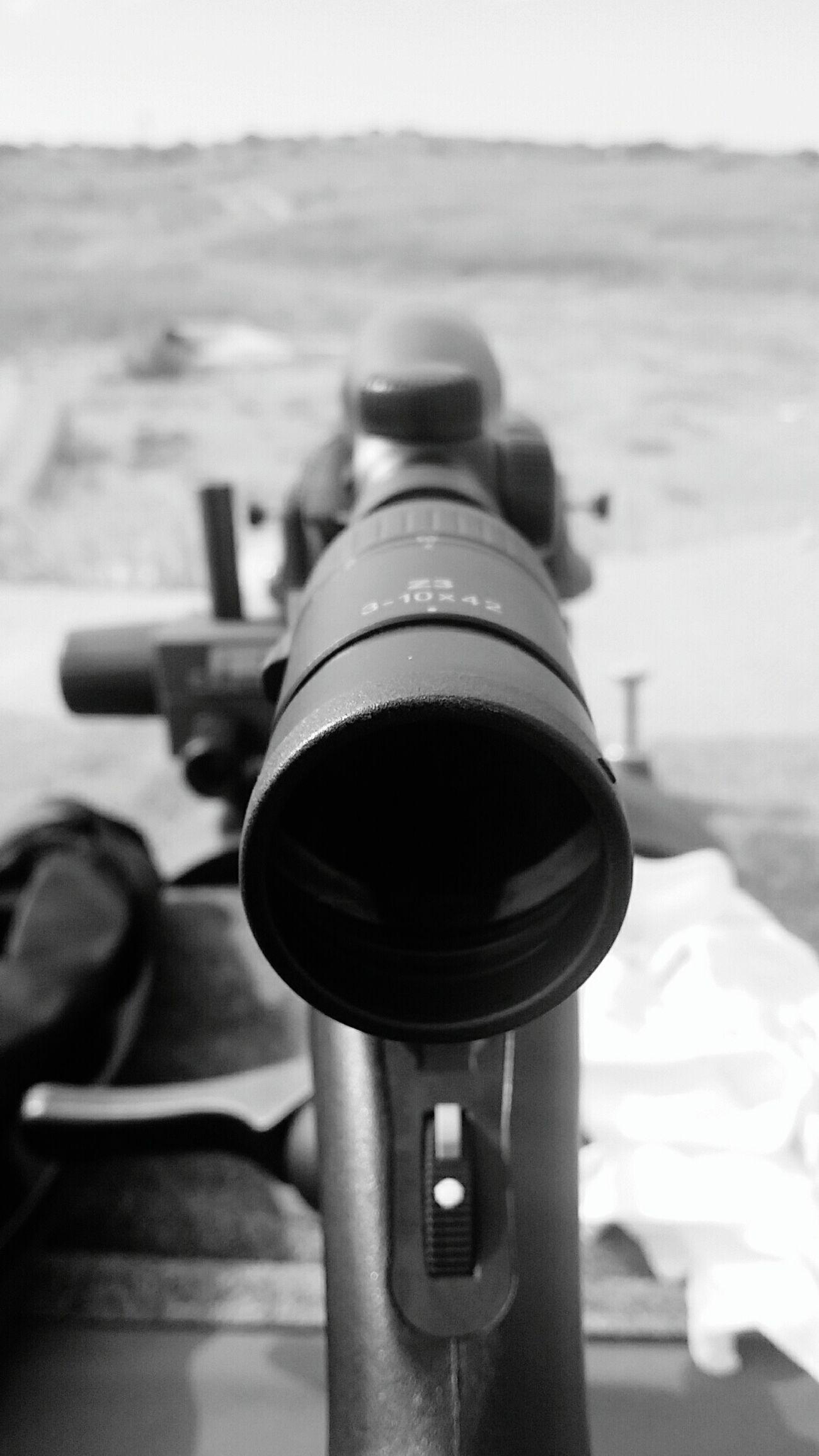 Focus On Foreground Close-up Outdoors Black & White Rifle Scope Shooting Range  Bullseye