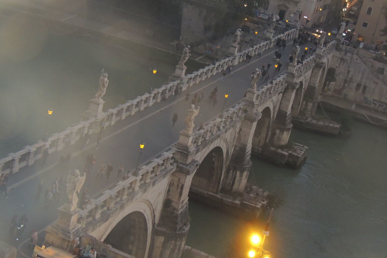 architecture, built structure, bridge - man made structure, travel destinations, tourism, illuminated, chain bridge, history, arch, connection, travel, building exterior, city, outdoors, transportation, water, no people, sky, day