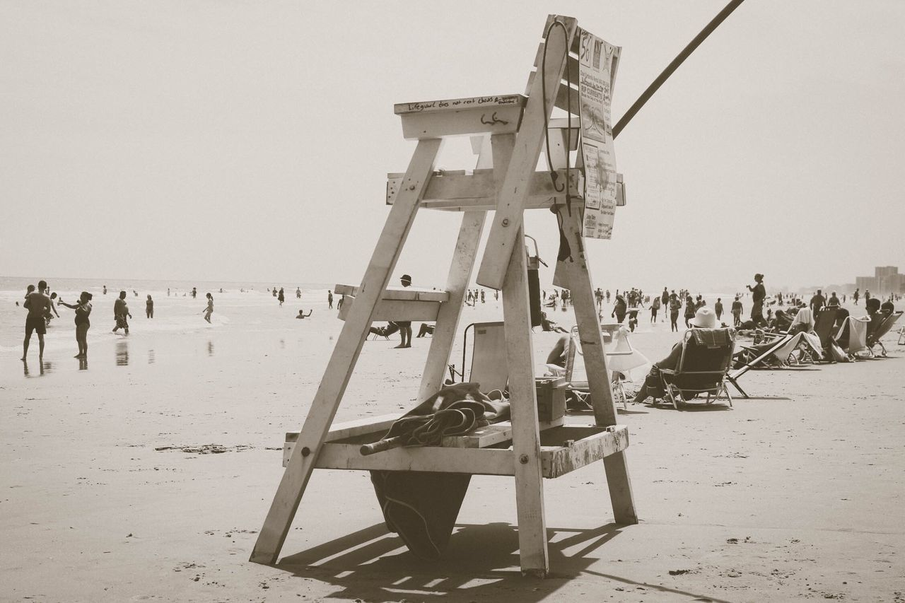 Beach Sand Large Group Of People Real People Sea Clear Sky Outdoors Men Sky Day Vacations Full Length Nature People Life Guard Stand Chair Life Guard Post
