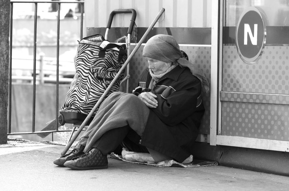 homeless woman sitting on the street Adult Adults Only Day Editorial Photography Full Length Help Me Homeless Indoors  Money Nostalgia One Person One Senior Man Only People Portrait Real People Senior Adult Senior Men Street Streetphotography Survival Woman Candid Candid Photography