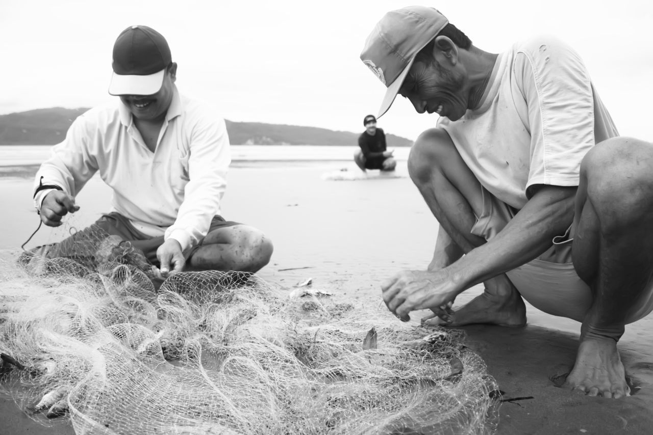 fisherman in pacitan eastjava Indonesia Adult Beach Black And White Day Fisherman Fishermen's Life Friendship Human Hand Men Only Men Outdoors People Real People Sitting Togetherness Two People